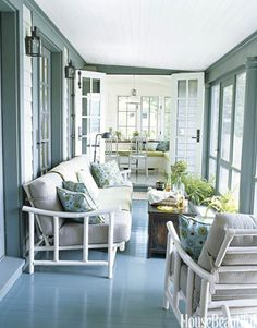 ❤ Paint the Floor- Architect Gil Schafer screened in this Connecticut lake cottage's open porch. Color expert Eve Ashcraft chose Narragansett Green for the porch floor from Benjamin Moore. The gleaming shade makes the floor almost look like water. The white-lacquered '50s rattan sofa and armchair are from the homeowner's grandmother.