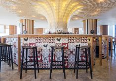You can't miss the doorman at Estado Puro, a tapas restaurant at the Hard Rock Hotel Ibiza in Sant Jordi, Spain. He's an 8-foot-tall red chicken, a resin version of ...