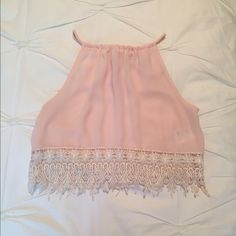 """Pink Lace-Trim Crop Top Only worn once or twice, so I've decided to let it go. This top features a suspended neck and a keyhole in back with tie closure. Perfect for adjusting the length and fit. Lace crochet detailing at hem. Cropped length at about 14"""" long. Urban Outfitters Tops Crop Tops"""