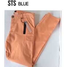 STS BLUE Skinny Cargo (Nordstrom) 60% cotton, 38% polyester 2% spandex. Color is melon. I don't usually pick up items that I can't find stock photos of but...these are SO DANG CUTE! Skinny style cargo pants. The cantaloupe color is so perfect for Spring, Ask questions! Retail: $58 at Nordstrom. Have 29, 31 & 32 please ask for separate listing Pants