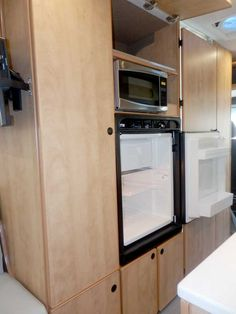 e40013c84c Sportsmobile Transit Extended Body (EB) camper van conversion features  inside and outside access to the galley