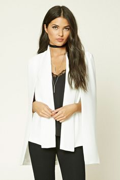 A woven cape blazer featuring an open front, lightly padded shoulders, a vest underlay, and long sleeves.