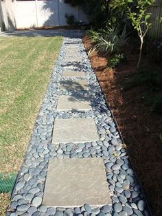 gardenfuzzgarden.com rock and paver walkway- maybe with pea gravel for a walkway to the hose? - gardenfuzzgarden.com