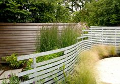 galvanized metal walls garden | curving fence made from strips of galvanized steel | designed by ...