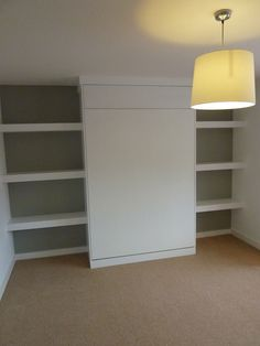 pull-down bed in custom made cabinet by Peter Henderson Furniture, Brighton, UK