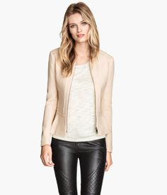 H&M Peplum jacket €39,99 Short, figure-fit jacket in a textured weave with a peplum, reverse-stitched seams, raw edges, and a zip at the front. Lined.