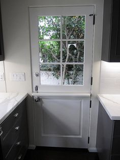 Fabulous white glass paned Dutch door leading into the kitchen. Doors, Dutch Door, Windows And Doors, Kitchen Doors, Windows, Home Remodeling, New Homes, House, Home Decor