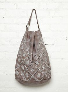 FP White Wash Stud Hobo.  The simplicity and ethnic feel of this piece can really bring out an outfit.  Washed out leather hobo bag with studded design on front. Slouchy, oversized shape.