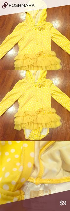 Bathing suit with long sleeves and a hoodie Super cute yellow bathing suit with white polka dots, a flower detail, and ruffles all around the bottom part of the suit. It has long sleeves and a hoodie to protect your baby girl from the damaging sun-rays yet still allowing the baby to enjoy a day at the beach or poolside. In excellent conditions, from a pet-free, smoke-free home. baby 8 Swim One Piece