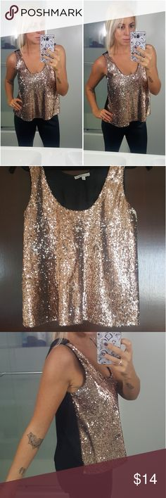 Rose Gold Sequins Crop Super flashy rose gold cropped tank. Super comfortable. Spandex cotton blend back. Meant to fit loose. Perfect for a night out for the holidays. Worn twice. Charlotte Russe Tops Tank Tops