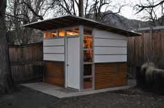 modern shed. corrugated metal siding on lower 1/3rd of house. horizontal. rusty!