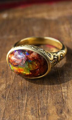 Alex Sepkus Circle set ring in 18k yellow gold with Mexican fire opal matrix. It is feeling very opalicious in the AS studio. All jewelry is handmade in NYC studio.