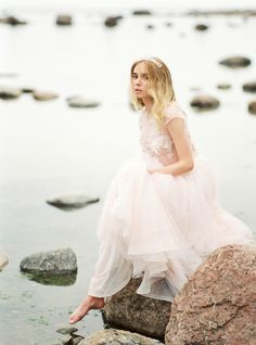 Romantic Seaside Wedding Inspiration in Blush wedding dress and wildflower bouquet. #blushweddings #elegantbrides #elegantbridalinspiration #beachweddingsinspiration