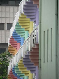Pastel spiral staircases belong to the backs of narrow stophouses in the Bugis area in Singapore