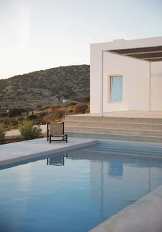 "Located on the Greek island of Paros, studio Re-act Architects designed a modern retreat as a reinterpretation of Cycladic architecture. Inspired by the traditional cubic form, architects Natasha Deliyianni and Yiorgos Spiridonos added a minimal touch to the white summer house titled 'Maison Kamari'. Nestled into the curve of the site's plot, the structure's design features an expansive terrace with a pool, overlooking the Aegean Sea. Speaking of the idea behind the concept, it says: ""The…"