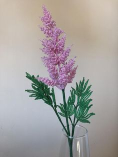The flower of pink astilbe consists of multiple sprigs located on a stem and forming the inflorescence. There two green leaves on the stem. The height of the flower is 45 cm. Seed Bead Flowers, French Beaded Flowers, Wire Flowers, Beaded Flowers Patterns, Beaded Jewelry Patterns, Crochet Flowers, Tambour Beading, Loom Beading, Beaded Crafts
