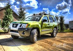 Kermie, the green Xterra. If you look closely you can see the frames mixed in Photomatix don't align. I'm thinking a tripod is a must for future true HDR