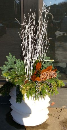 Outdoor Holiday Bouquet The holiday season is upon us and it's time to make those planters festive. Choose a variety of greens and natural items and arrange them like you would a bouquet. Now is the time to prune evergreens and deciduous shrubs for your planters.