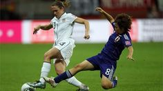 FRANKFURT AM MAIN, GERMANY - JULY 17: Aya Miyama of Japan (R) challenges Heather O'Reilly of USA (L) during the FIFA Women's World Cup Final match between Japan and USA at the FIFA World Cup stadium Frankfurt on July 17, 2011 in Frankfurt am Main, Germany. (Photo by Christof Koepsel/Getty Images)