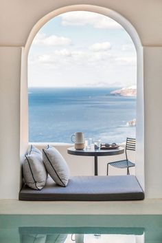Beautiful views out across the sea framed by a seated archway - aboratorium renovate seven suites at Porto Fira luxury hotel in Santorini, Greece. Luxury hotel designs feature on the www. Santorini Hotels, Santorini Greece, Santorini Island, Greece Hotels, Mykonos, Fira Greece, Santorini House, Santorini Caldera, Santorini Honeymoon