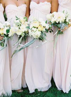 Bridesmaids bouquets of ivory dahlias, hydrangeas & quicksand roses tied together with velvet ribbon Event Design: Easton Events Photography: Jose Villa Florals: Saipua Bridesmaids Dresses: Monique Lhuillier
