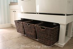 Built up riser made of wood under washer & dryer with tutorial at link. Not too small of a laundry room, so this would really make great use of space in a smaller area as well.