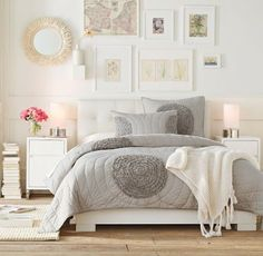 Love the bedspread! Would add a little more grey and some black accents to the room.