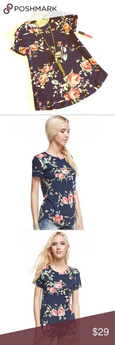 """Floral Print shirt Navy tee shirt with coral floral print. Soft jersey tee shirt.   Fabric: 95%RAYON 5%SPANDEX  Made in U.S.A. Model is 5""""8 and is wearing a small Tops Tees - Short Sleeve"""