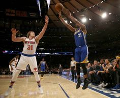 Ron Baker of the New York Knicks tries to block a shot from Ian Clark of the Golden State Warriors at Madison Square Garden on March 5 2017 in New...