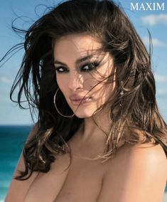 Posing with her hair in tousled waves, Ashley Graham smolders in this topless shot