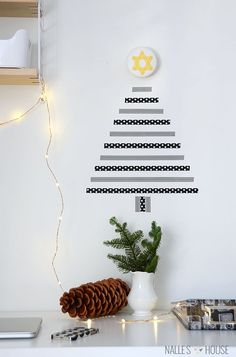 If you have decorated your Christmas tree, It is time to decorate the walls now. If you want to see examples, you should check these 30 Amazing DIY Christmas Wall Decor Ideas. Here's a collection of the best DIY Christmas wall decor ideas to Wall Christmas Tree, Noel Christmas, Simple Christmas, Xmas Tree, Christmas Crafts, Christmas Decorations, Christmas Wall Decorations, Minimalist Christmas, Homemade Christmas
