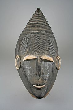 Helmet Mask Date: 19th–20th century Geography: Nigeria Culture: Igbo peoples Medium: Wood, pigment Dimensions: H. 15 7/8 x W. 13 1/8 in. (40...