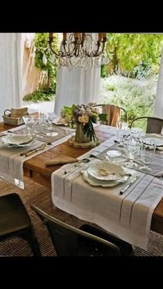 Table setting a simple container of flowers is accessory enough