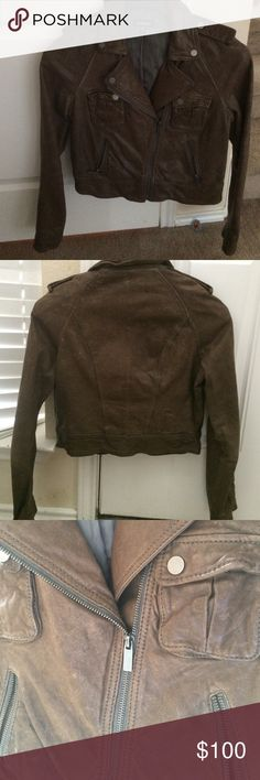 Brown bomber jacket Brown 100% leather cropped bomber jacket.  Lined in the inside and super soft outer shell.  Just needs a leather cleaner but I don't have any.(pic 3) Has a distressed look naturally. bebe Jackets & Coats