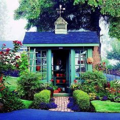 Wow,  I'm loving the color on this shed  via Better Homes and Gardens