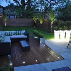 We love this contemporary deck idea with lovely design details such as built in lights and topiary.