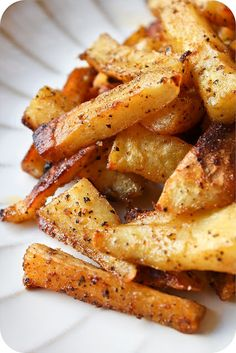 Spiced Sweet Potato Fries : 2 large sweet potatoes (peeled and cut into sticks) * 3 tbsp olive oil * ½ tsp black pepper * ¼ tsp cayenne pepper * ¼ tsp paprika * ¼ tsp cumin * ¼ tsp garlic powder