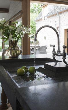 Soapstone kitchen sink & bridge faucet