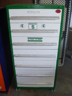 """7-drawer Stanley Vidmar-style tool cabinet with MSU painted theme, 30"""" W x 27.75"""" D x 61.125"""" H; up for auction this September through Viperbid Michigan."""