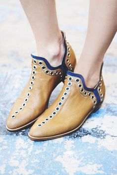 Chic pointed toe shoe boot with grommet accents http://rstyle.me/~2D44j