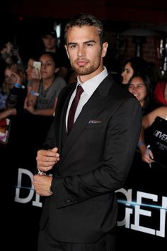 Theo James is adjusting his cuffs in preparation for ripping my hormones right out of my body. Dude looks unbelievable in that get up.