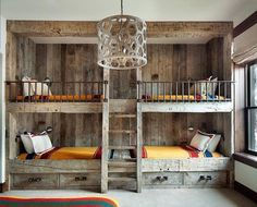 Rustic country bunk room features built-in barnwood bunk beds dressed in yellow bedding flanking a rustic bunk bed ladder illuminated by a wood geometric drum pendant. (Cool Rooms With Bunk Beds) Cabin Decor, Rustic Bunk Beds, Home Decor, Country Boys Rooms, Loft Spaces, Built In Bunks, Remodel Bedroom, Cottage Bedroom, Yellow Bedding