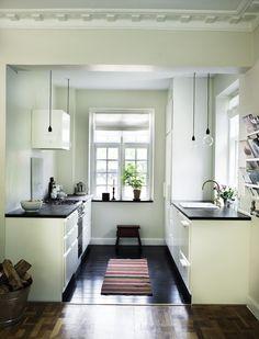 Simple Modern Kitchen in black & white.  stylist: kml design  photographer: Mikkel Adsbøl