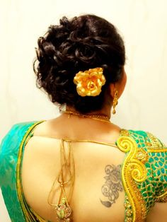 Indian bride's bridal reception hairstyle by Swank Studio.