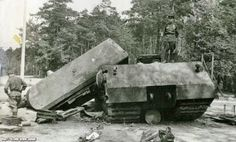 Soviet soldiers investigating destroyed Maus prototype at Kummersdorf proving grounds