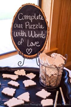 Modern version of a wedding guest book by Bella Puzzles. Cute chalkboard instruction sign! Photo by Bubblewood Photography.