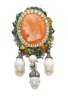 AGATE CAMEO, NATURAL PEARL, ENAMEL AND DIAMOND BROOCH, CIRCA 1865. The agate cameo depicting Hercules in profile wearing a lion skin, set within a surround of cushion-shaped and circular-cut diamonds, to a foliate frame highlighted with green enamel, suspending natural pearl pendants.