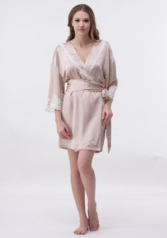 This elegant silk short robe is adorned by feminine fret-work lace at the front and sleeves. With a self tie at waist.