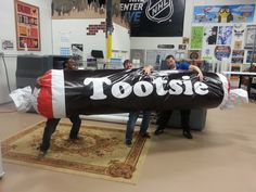 Who says you can't have fun at work! This is what we do on a little down time! We printed this on our HP Scitex 600 and stuffed it full of craft paper. It's now hanging from the ceiling in our shop, come check it out! #tbt #tootsieroll #fun #heritageprinting