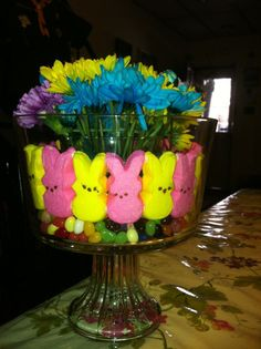 Use jelly beans, mm peeps bunnies and fresh flowers to make a beautiful and easy Easter Centerpiece.